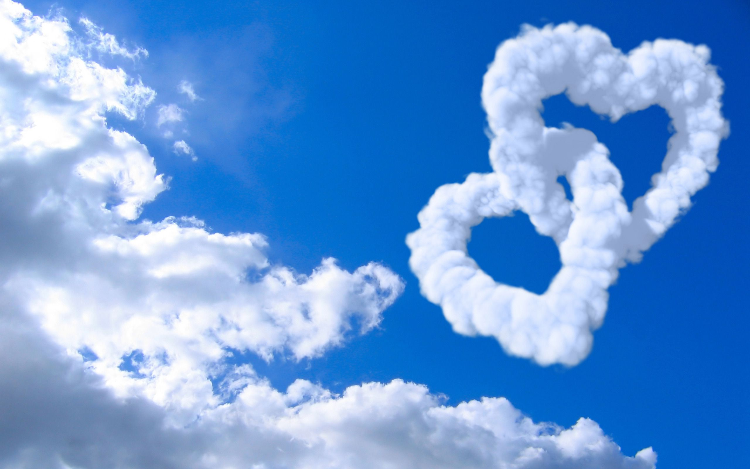 love_hearts_clouds_in_blue_sky-wide